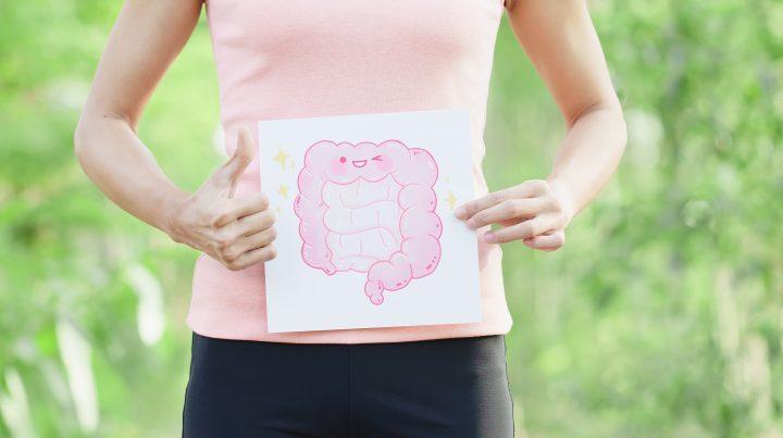 sport woman take intestine board with green background